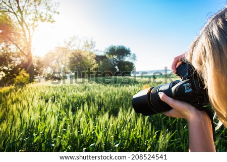young blonde girl making photo - stock photo