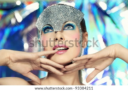 young blonde girl wearing a silver glittering crown in disco style - stock photo