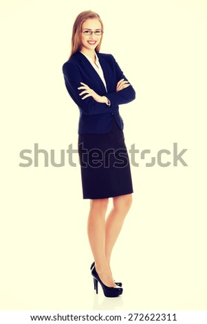 Young blonde happy businesswoman standing - stock photo