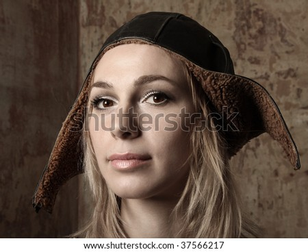 Young blonde in the flying helmet - stock photo