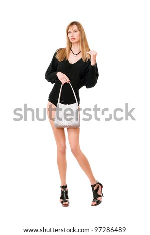 Young blonde lady with the white purse - stock photo