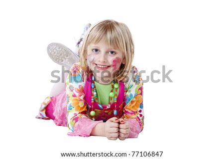 Young blonde pretty girl in carnival fancy dress lies on the floor and laughs.Isolated on white background. - stock photo