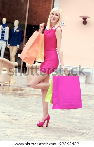 Young blonde shopping woman with bags ,Tuscany Italy