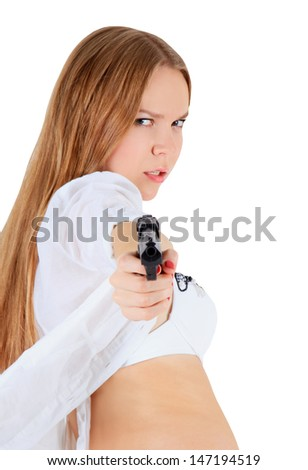 Young blonde with a gun - stock photo