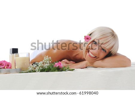 Young blonde woman at spa procedure Isolated on white background - stock photo