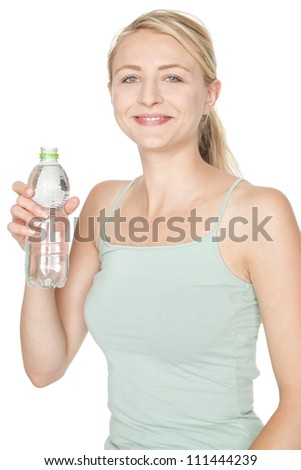 young blonde woman drinking water after sport - stock photo