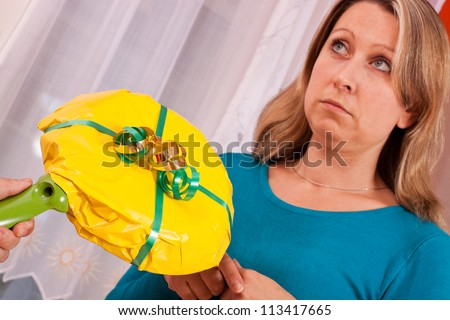 young blonde woman gets a thoughtless gift - stock photo
