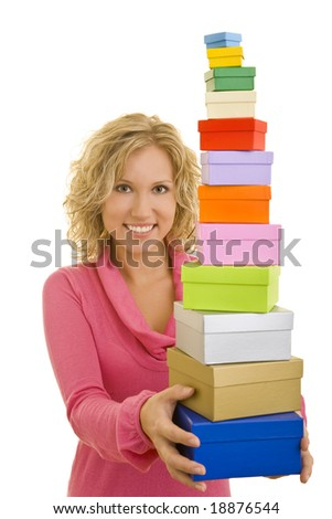 Young blonde woman holding a stack of gift boxes
