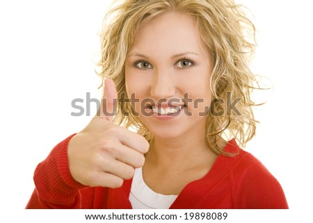 Young blonde woman holding her thumb up - stock photo