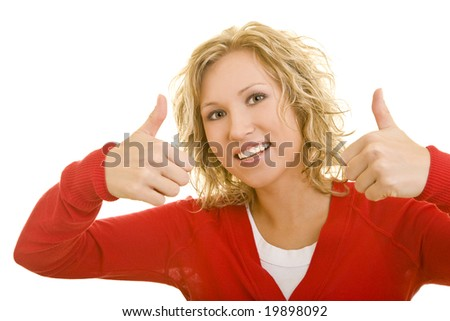 Young blonde woman holding her thumbs up - stock photo
