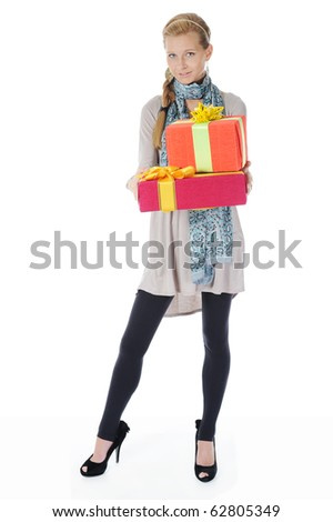 Young blonde woman in a full-length with a gift box. Isolated on white background