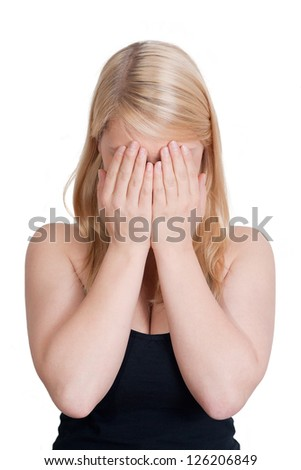 young blonde woman is frustrated - isolated on white background - stock photo