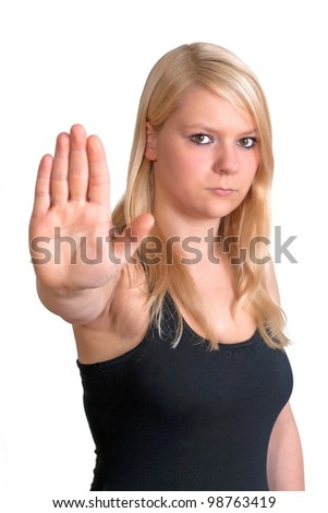 young blonde woman is showing the stop gesture - stock photo