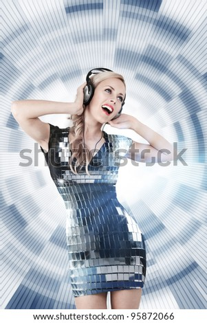 Young blonde woman listening disco music in headphones - stock photo