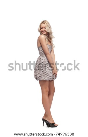 Young blonde woman  looking back through a shoulder - stock photo