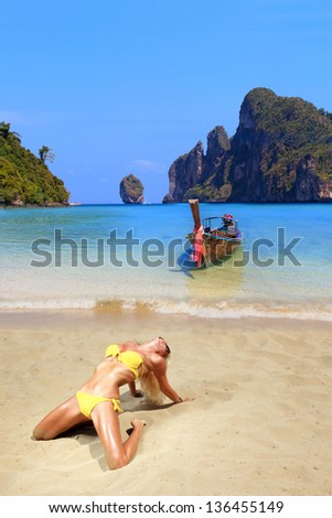 Young blonde woman on Phi Phi island beach in Thailand - stock photo
