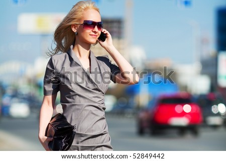 Young blonde woman on the phone. - stock photo