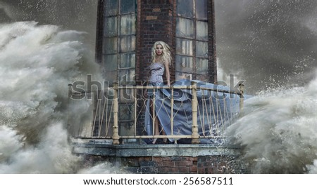 Young blonde woman on the sea storm - stock photo