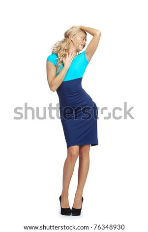 Young blonde woman  posing in stylish blue dress - stock photo
