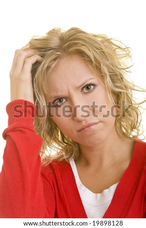 Young blonde woman scratching her head - stock photo