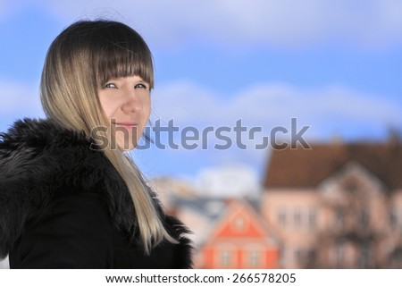 Young blonde woman smiling and looking to the camera head and shoulders portrait - stock photo