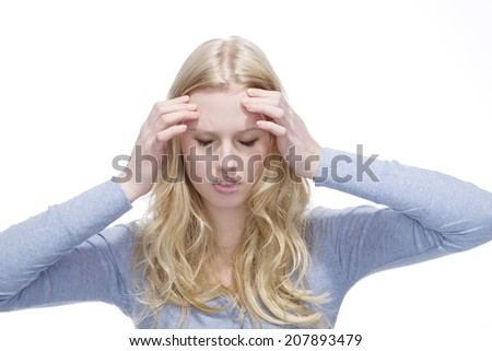 Young blonde woman suffering from headache