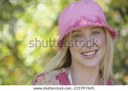 Young Blonde Woman Wearing Hat - stock photo