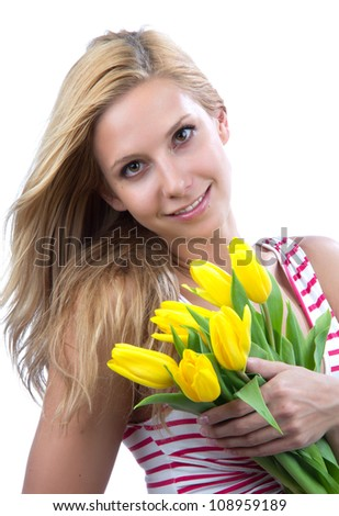 Young blonde woman with flowers yellow spring tulips bouquet smiling isolated on white background - stock photo
