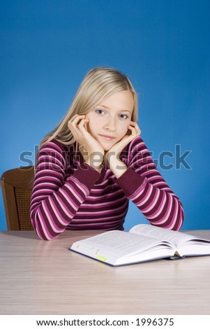 young blonde woman with open book (blue background) - stock photo
