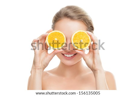 Young blonde woman with orange in her hands studio portrait isolated on white background