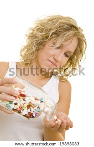 Young blonde woman with pills - stock photo