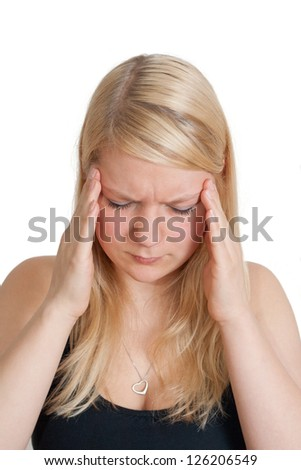 young blonde woman with splitting headache - isolated on white background - stock photo