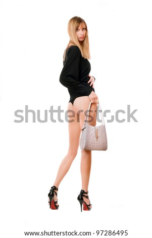 Young blonde woman with the white purse - stock photo