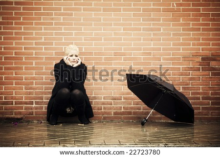 Young blonde woman with worried expression. - stock photo