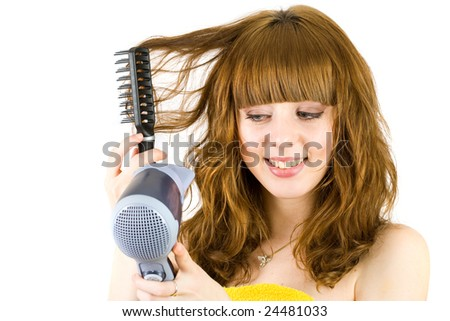 Young blonde woman  wrapped in yellow towel, using hair drier
