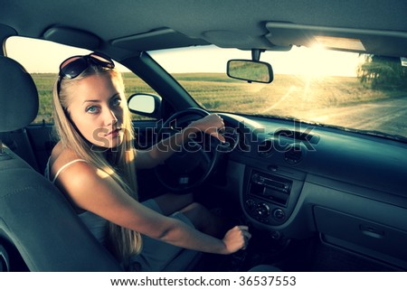 young blonde women in the car - stock photo