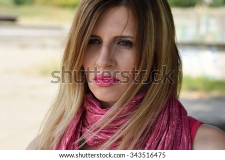 young blondy woman with pink scarf and natural big pink lips  - stock photo