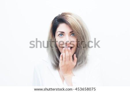 Young blue eyes blonde woman amazed expression isolated on white portrait - stock photo