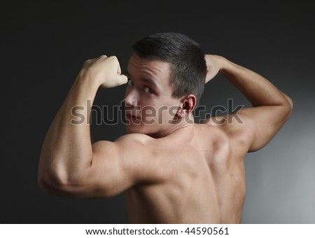 young bodybuilder - stock photo