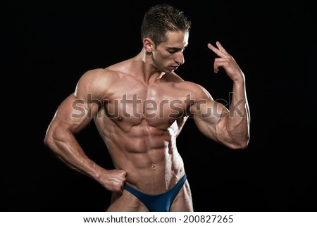 Young Bodybuilder Flexing Muscles - Isolate On Black Background - Copy Space