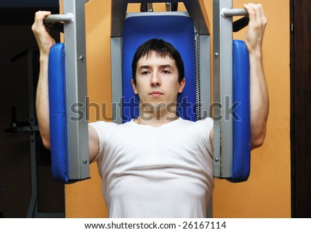 Young bodybuilder in a gym at workout