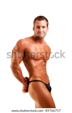 young bodybuilder posing over white