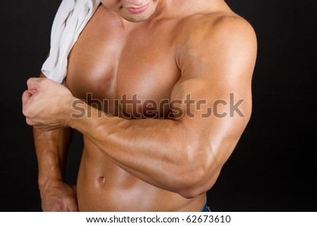 Young bodybuilder's sexy muscular arm