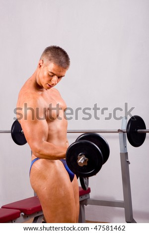 young bodybuilder training in gym - stock photo