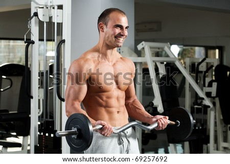 young bodybuilder training in the gym - e-z bar biceps curl, start position - stock photo