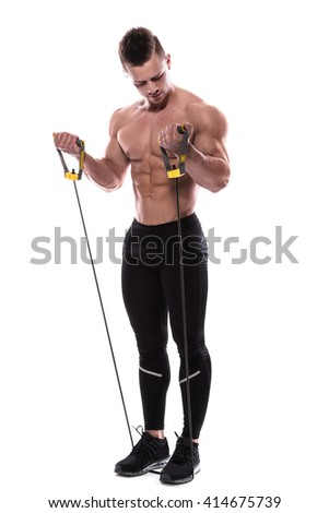 Young bodybuilder working out with rubber band over white background - stock photo