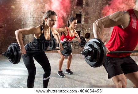 young bodybuilders have training with dumbbell