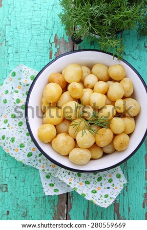 young boiled potatoes with butter and dill - stock photo