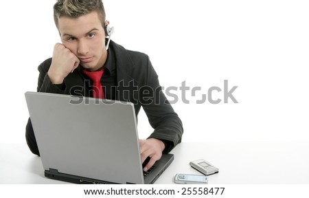 Young bored businessman with laptop and microphone