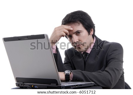 young bored man and working with is laptop